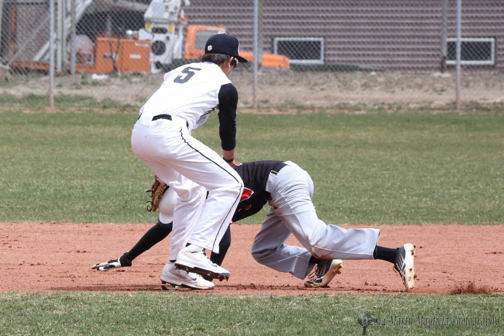 Dante Mileta makes the tag well before second base.