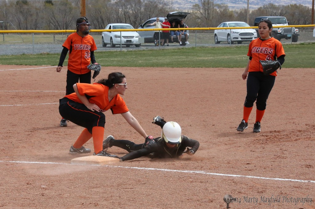 Sarandon Walton is safe back at First on the throw from home to catch her off guard.