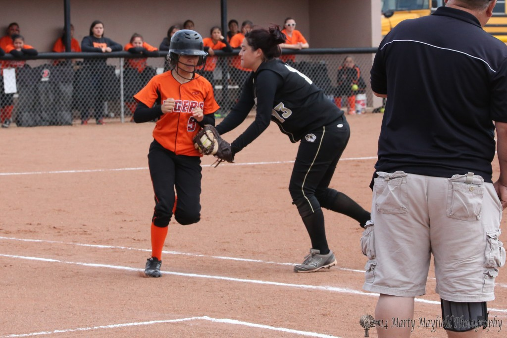 Tina Jaramillo makes the tag after a bunt travels the first base line in the game with Taos
