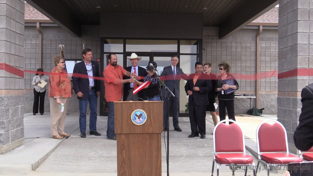 The Ribbon is cut as Retired General Gene Sisneros and Army Veteran Robert Vigil were given the honors of cutting the ribbon at the opening of the new VA Clinic in Raton on Friday (April 25, 2014)