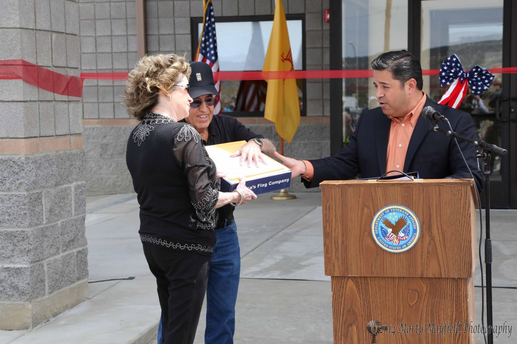 Congressman Ben Ray Lujan presented a flag that flew over the US Capital on April 7, 2014 to Charlene Spicolla and Retired General Gene Sisneros