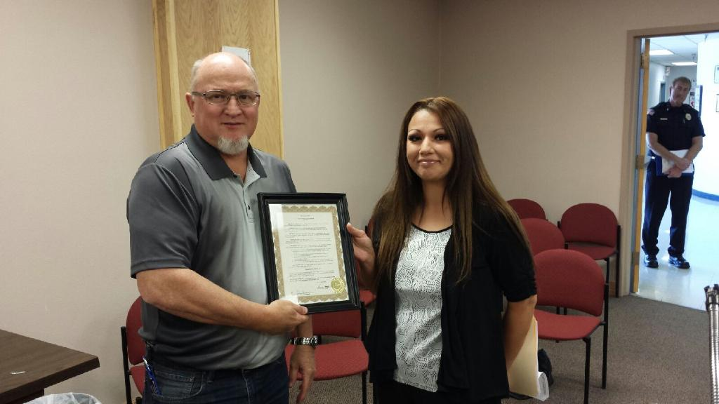 Danielle Archuleta accepts the proclamation from Mayor Pro-Tem Neal Segottta for Mental Health Awareness Month at the Tuesday afternoon city commission meeting.