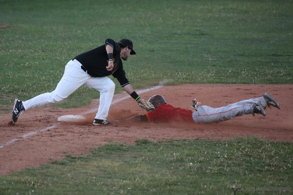 The call is out as Omar Artsen slides into third. This was a contested call by the Fuego Coach Bill Moore