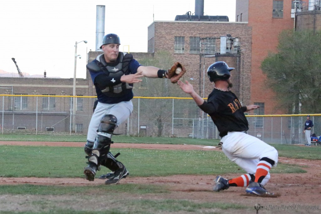Cie Arell is tagged by Taos catcher Matt Calden as Arell heads for home