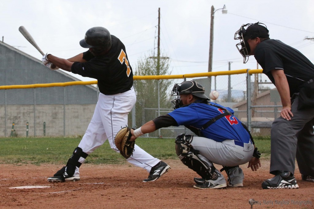 Justin Pearson also gets a piece of the ball as it flies by the catcher Brett Mendoza