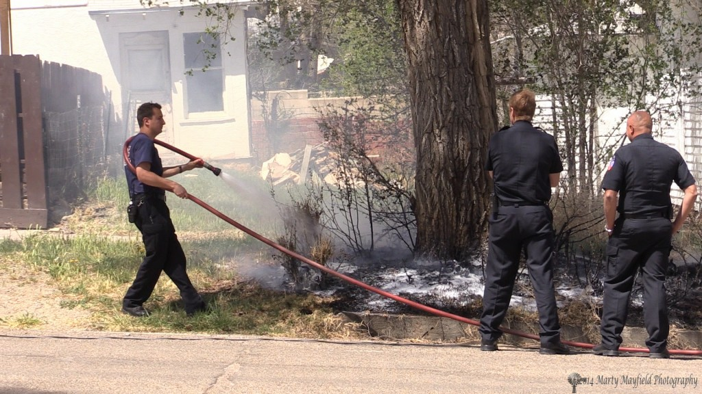 Raton Fire fighters extinguished this small grass fire that was caused by a downed drop wire to a light pole that fell over into Clark Ave Wednesday afternoon.