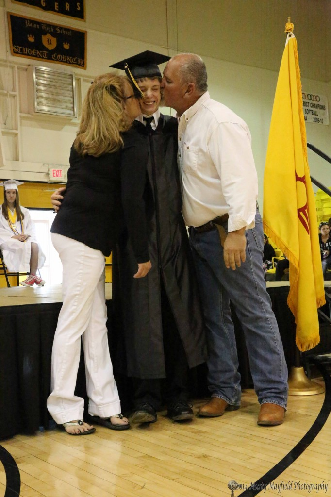 Toby Henson gets the special treatment from class sponsors Cindy Berry and Hunker Main after receiving his scholarship awards.