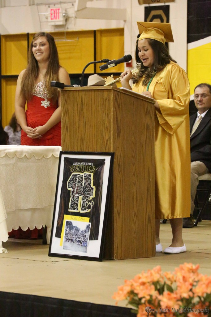 Rachel Sanchez Senior Class President passes the key to Junior Class Presidenta Rhiannon Barela