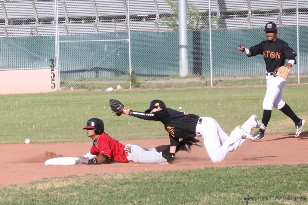 Omar Artsen slides safe into second base as shortstop Aaron Olivas looses the ball in the collision Wednesday evening.