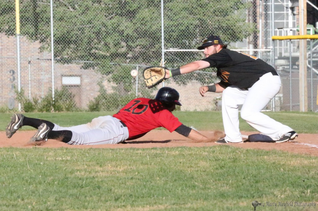 First baseman Chris Williams goes for the grab as Eric Kozel dives in under Williams for the bag.