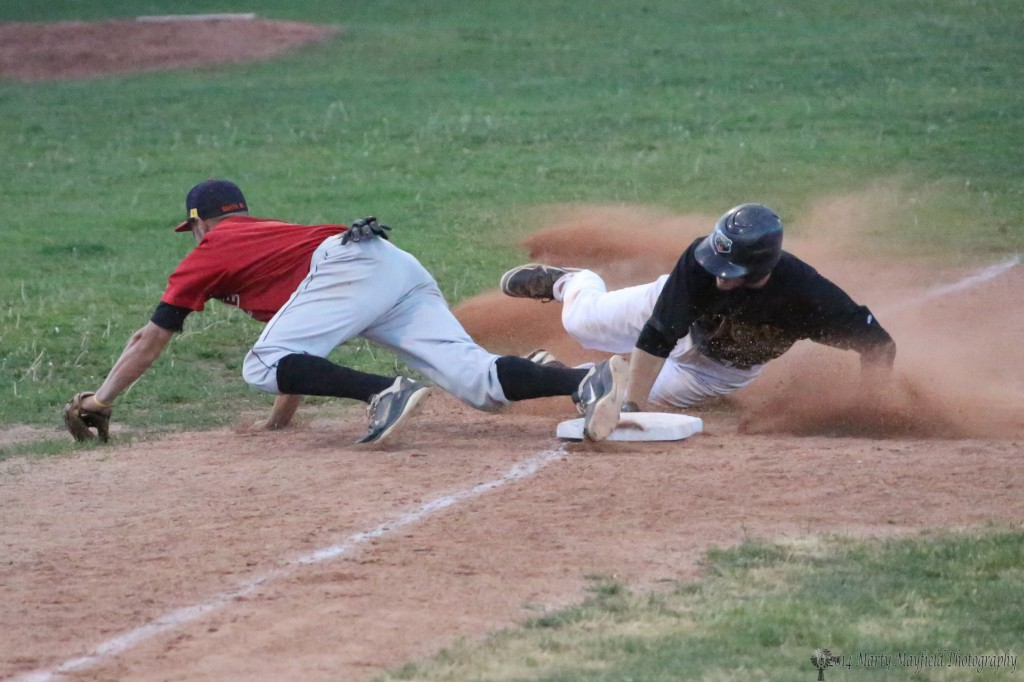 The ball gets loose from 3rd baseman Aaron Carmen as Chris Williams slides into third base