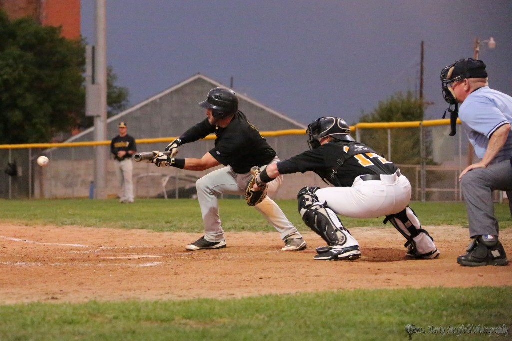 Shortstop Michael Morris goes for the bunt