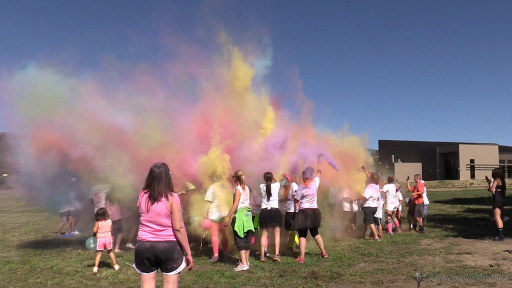 Colored powered filled the air as the Color For The Cure cancer fund raising event came to a close Saturday morning at Roundhouse Park.