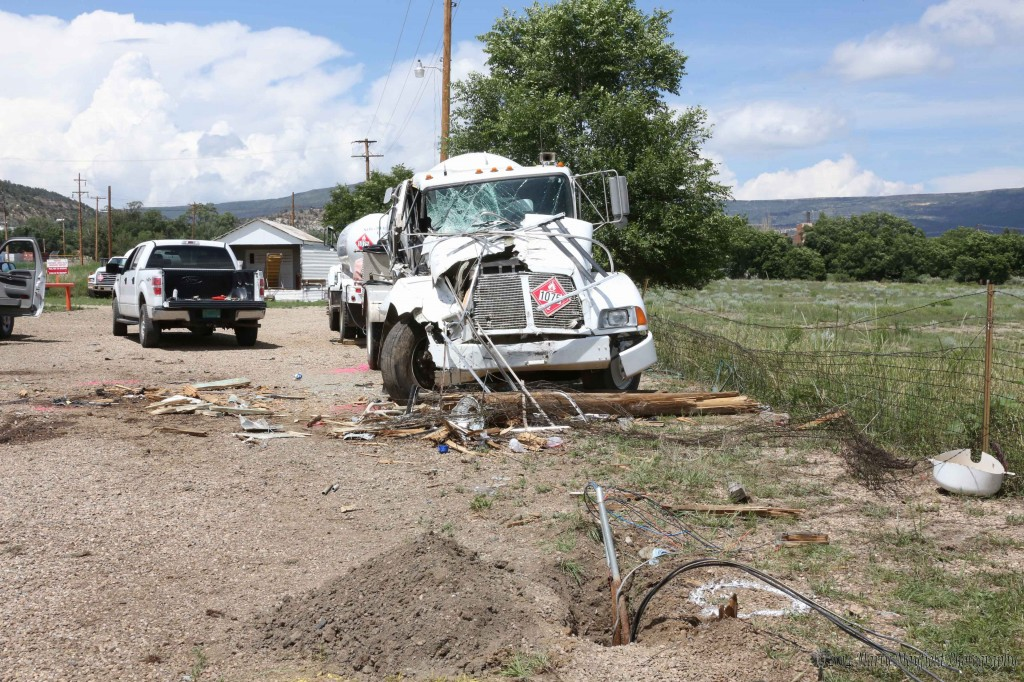 The front end of the propane truck at Northern New Mexico Gas Company. Note the partial light pole in front of the vehicle that the speeding vehicle took out.