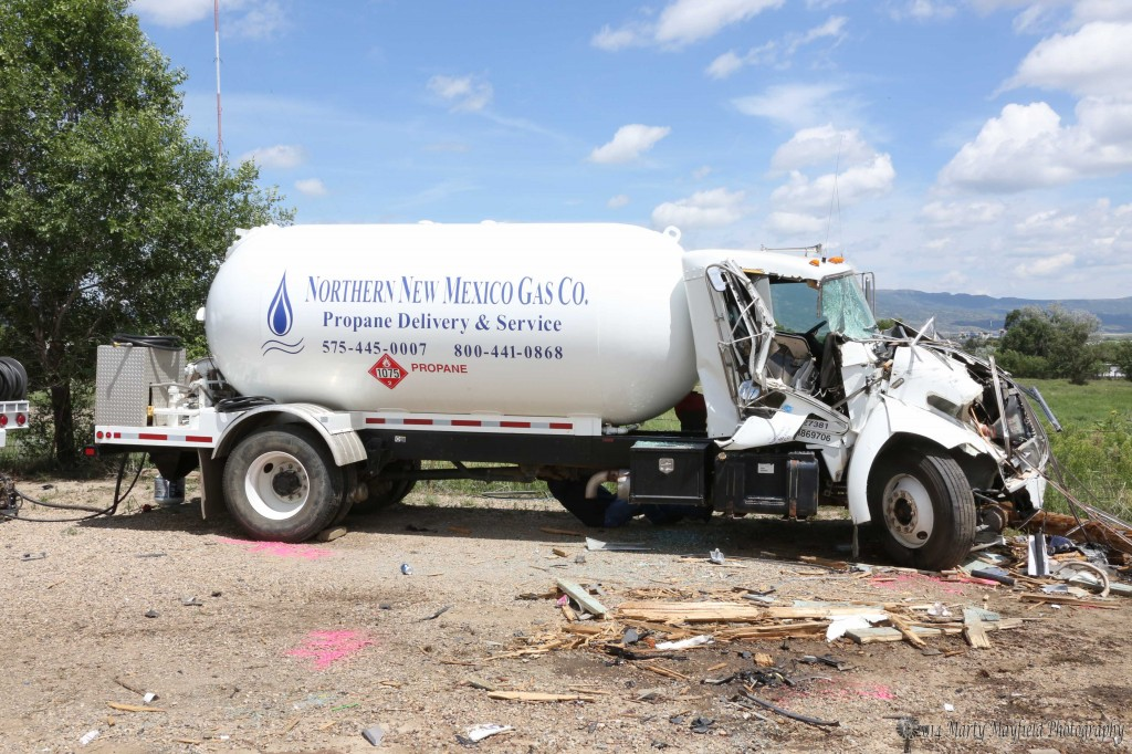 Side view of the Propane truck. According to Northern New Mexico Gas the truck only had 20% of a load on. The engine and cab took the brunt of the impact and no damage was sustained by the tank or plumbing on the back.