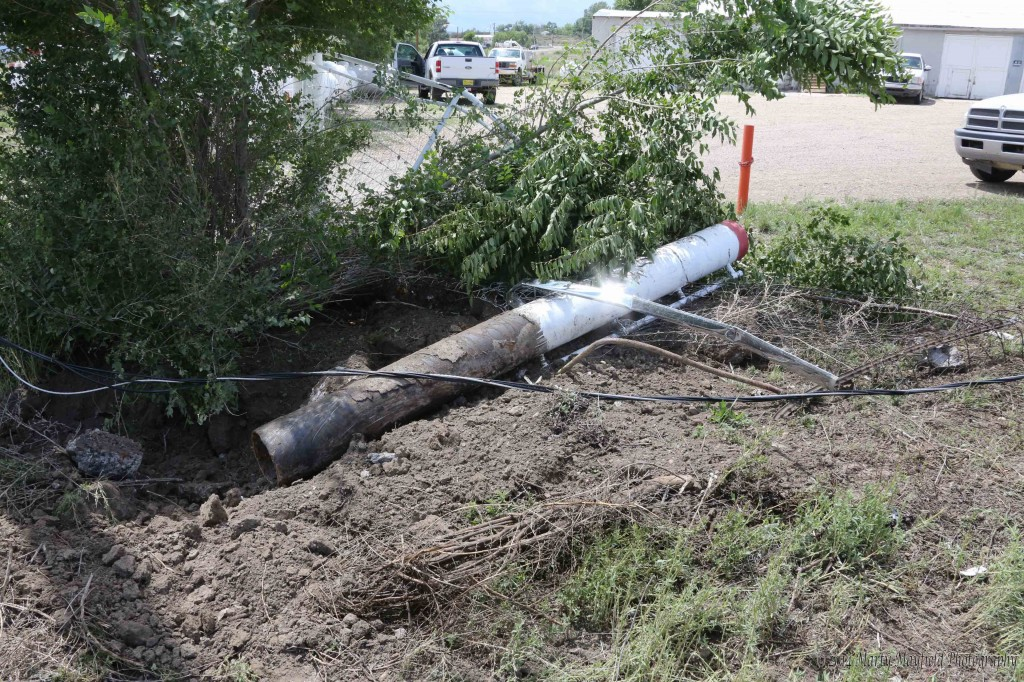 This 8 ft pipe post buried in the ground with cement was the first object hit by the speeding car.