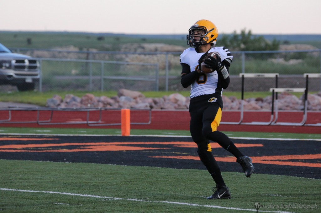 Dylan Query takes the opening kickoff in La Junta Friday evening