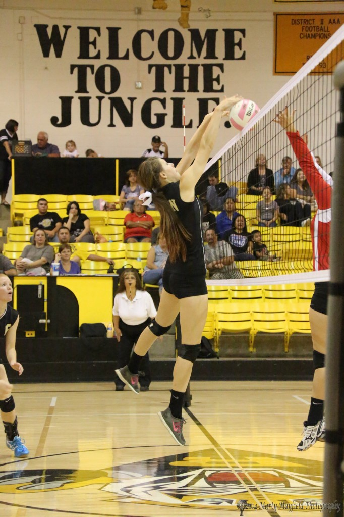 Kristina Jansen makes the block at the net during the match with Robertson