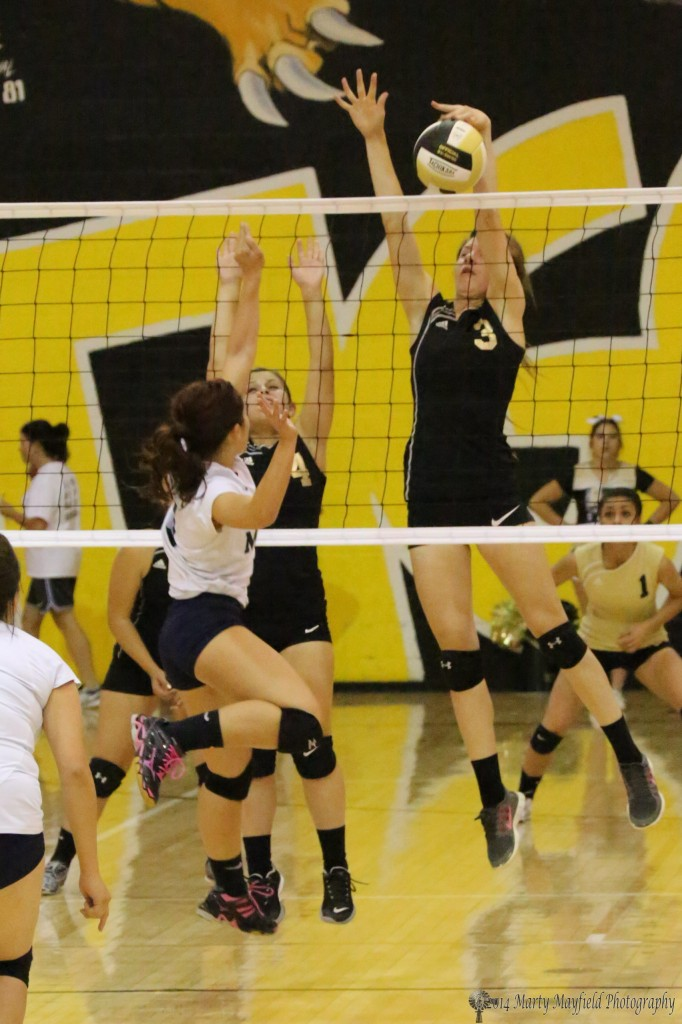 Kristina Jansen had a good night at the net as she gets a hand on the tip and sends it back over the net