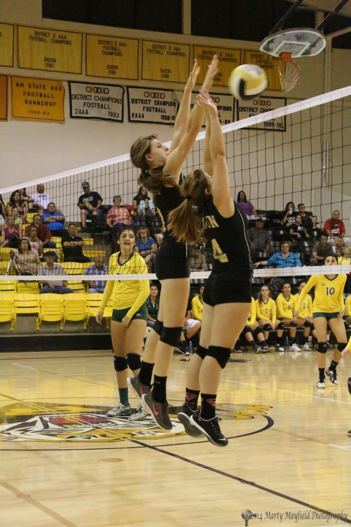 Kristina Jansen and Montana Trujillo go for the block Tuesday evening.