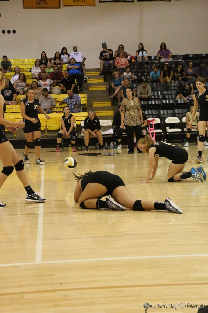 The ball falls in open court as the girls look on