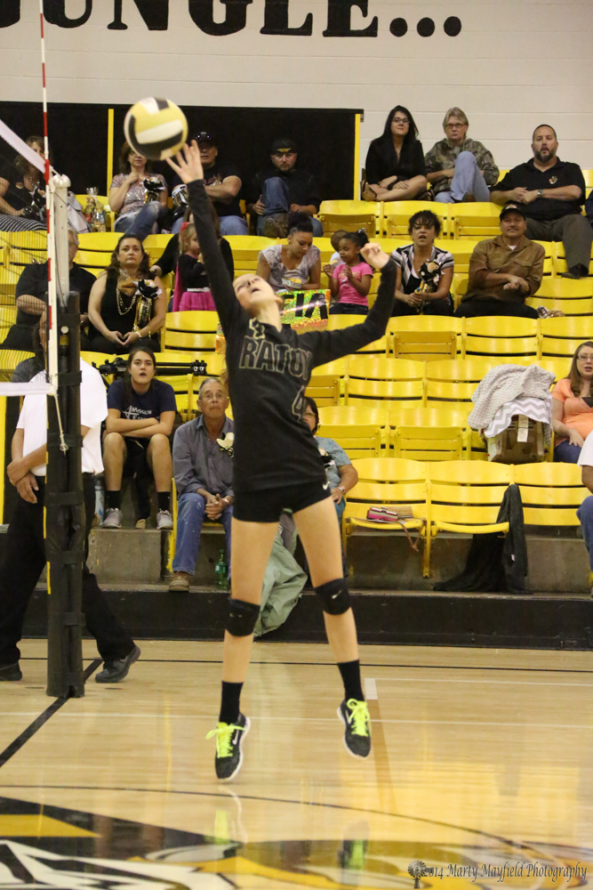 Camryn Mileta tips the ball over the net early in the first game against Clayton Thursday afternoon.