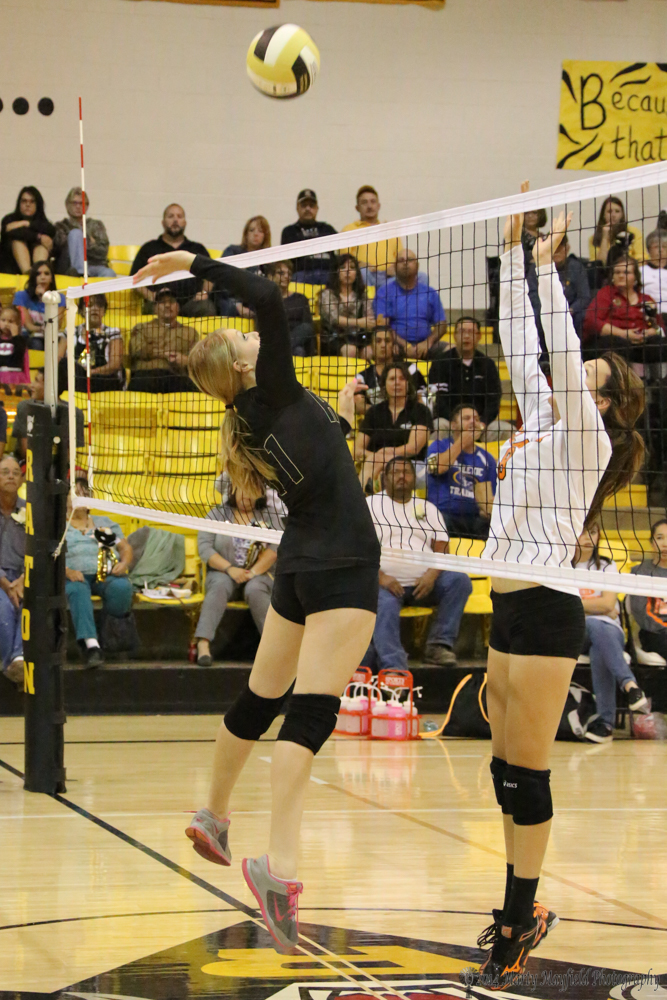 Ivy Fernandez gets one over as Yellowjackette Makayla Baker goes for the block