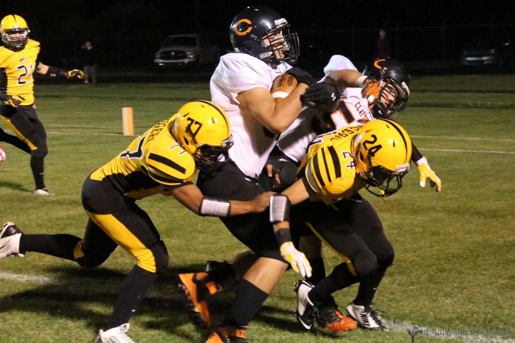 """Out sizing Raton's freshman defense 6'4"""" 260 pound Mark Craine pounds the ball into the end zone for the 2-point conversion on Clayton's first score of the evening."""