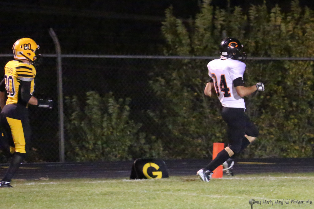 Speedster Koy Geary, well ahead of Martin Ortiz, crosses the goal line after racing 61 yards.