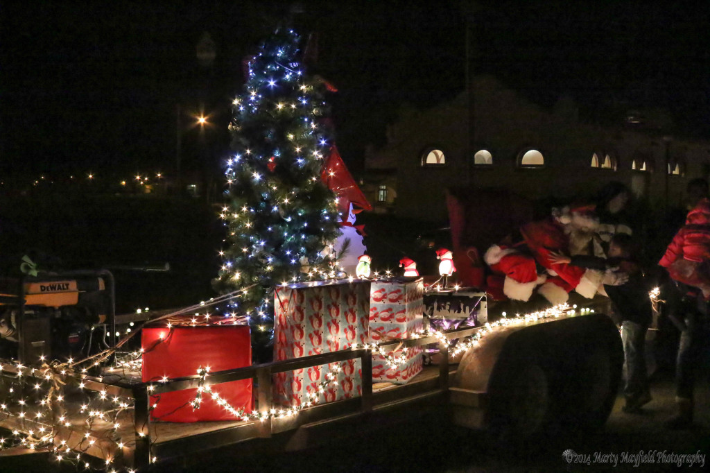 Santa Greets youngsters on this float Saturday evening during the electric light display