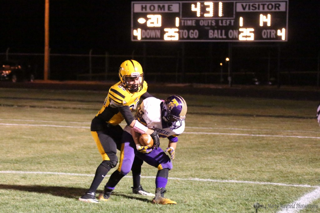 3 of 5  Daniel Lopez makes the interception late in the game Friday night but the call was incomplete pass, here Martin Ortiz is pulling the ball away and will eventually end up with it out of bounds