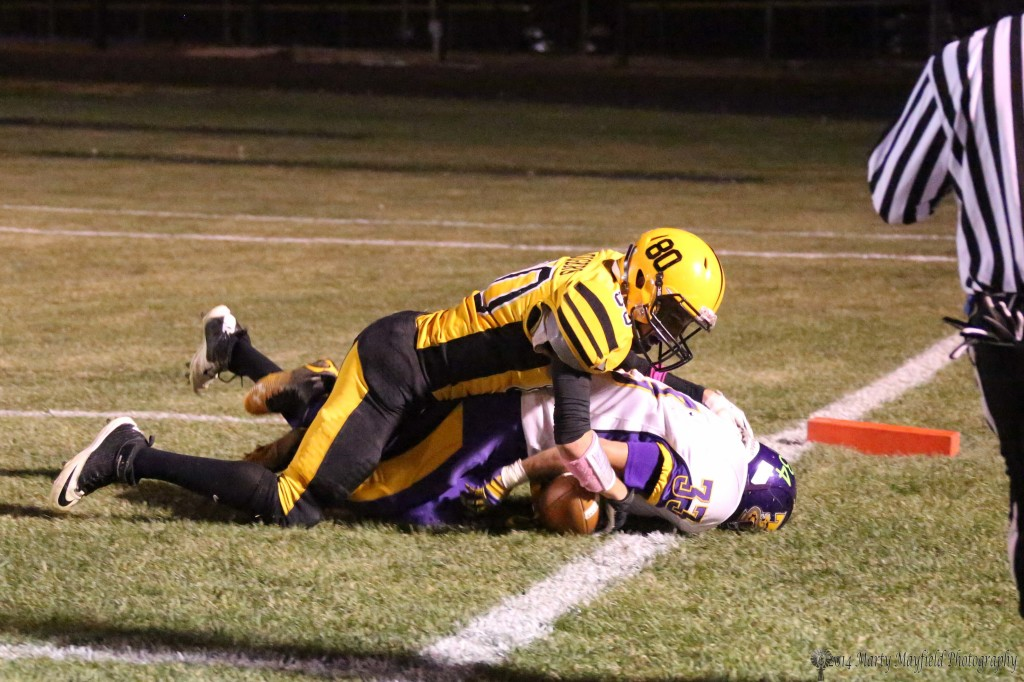 5 of 5   Daniel Lopez makes the interception late in the game Friday night but the call was incomplete pass, as the players tumble over Martin Ortiz will have the ball out of bounds and the call by the referee will be an incomplete pass.