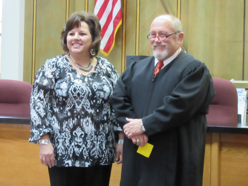 Colfax County Assessor Linda Gallegos was sworn in by District Judge John Paternoster Monday afternoon