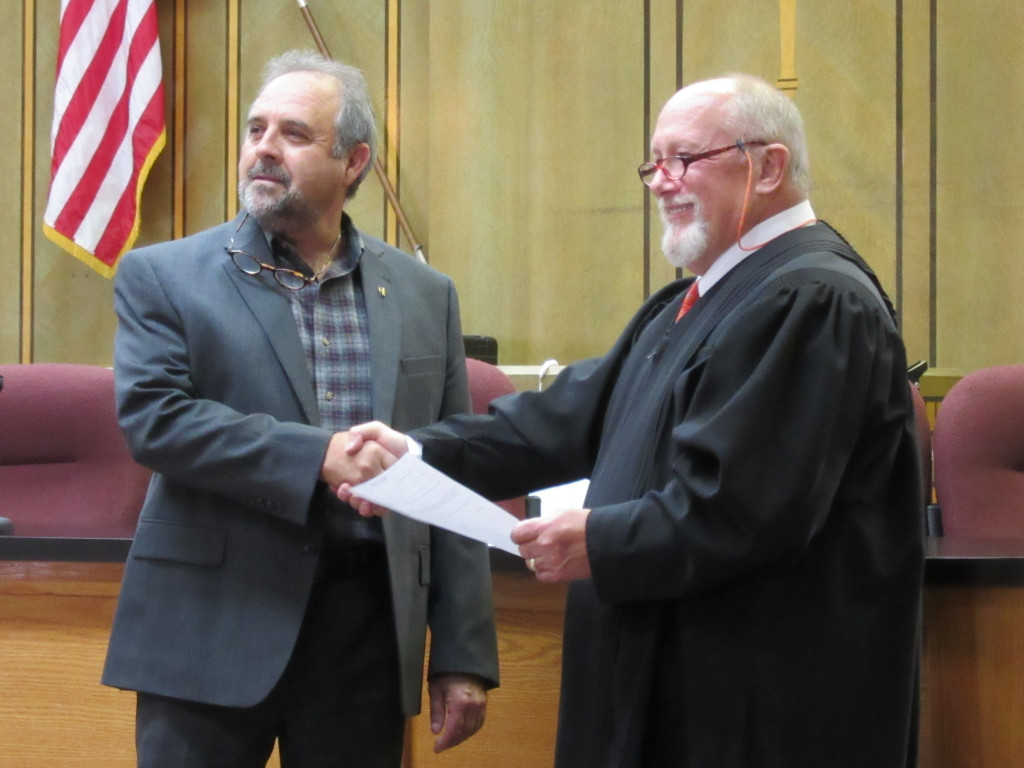 New Colfax County Commissioner Roy Fernandez took the oath of office from District Judge John Paternoster