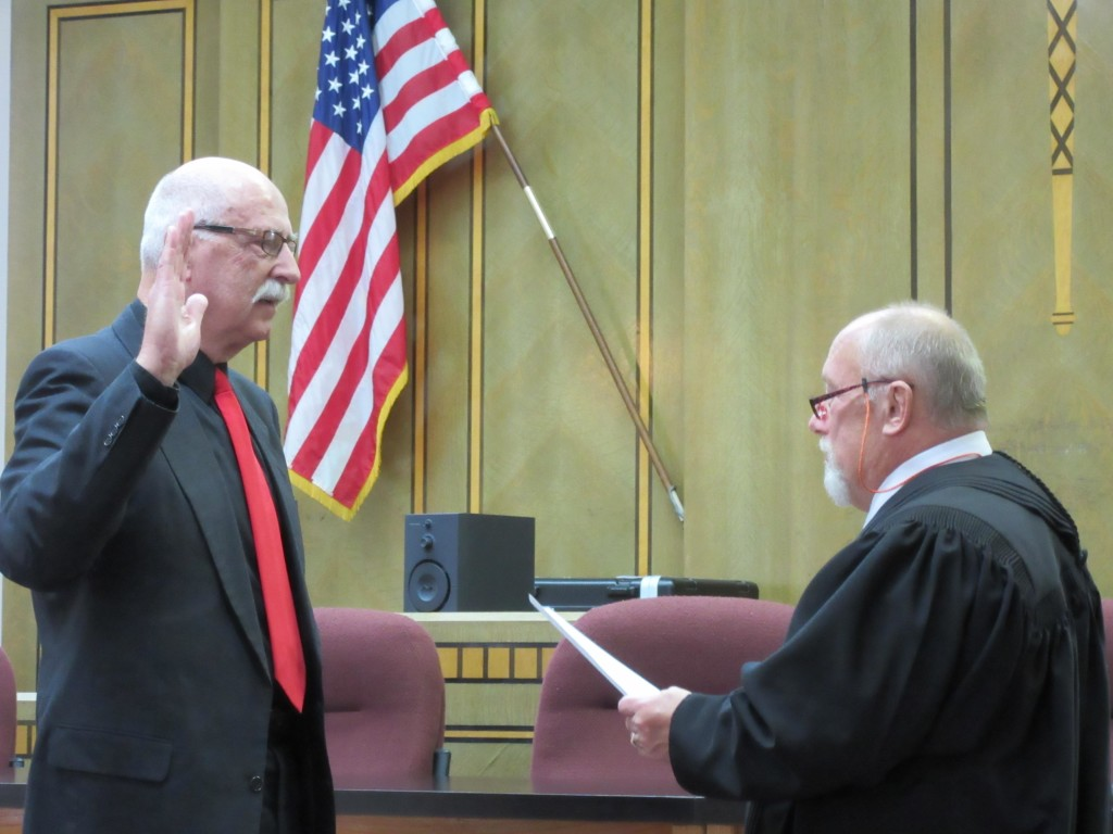 Probate Judge Roy Ackerman is sworn in Monday afternoon by district Judge John Paternoster