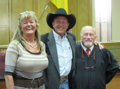 Connie Sinclair, Colfax County Sheriff Rick Sinclair and District Judge John Paternoster after the swearing in ceremony at the Colfax County Building.