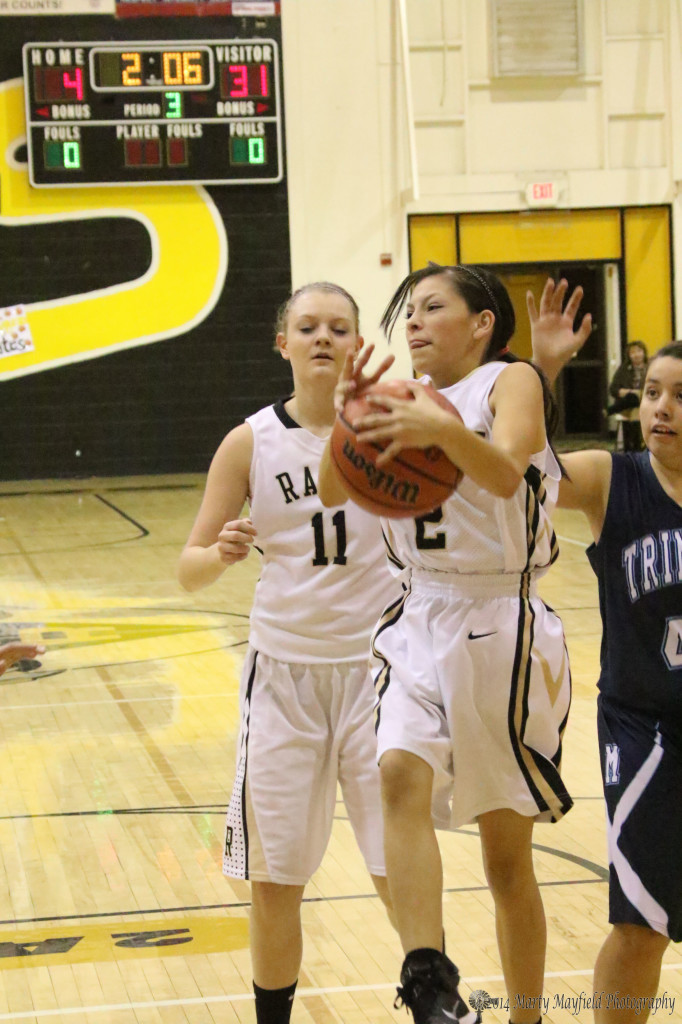 Syria Atencio gets the rebound among all those tall girls against Trinidad Tuesday evening.