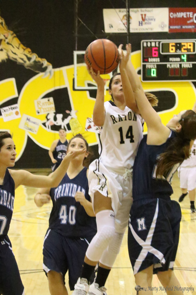 Briana Pais slides past Brittnee Coberly for the lay-up against Trinidad Tuesday night.