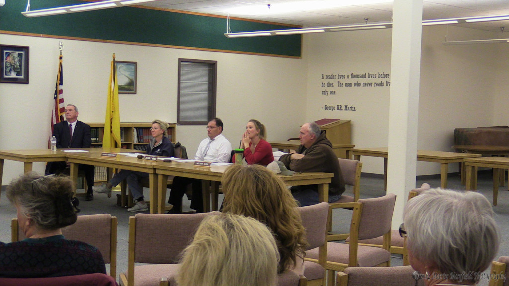 The Raton Public School Board of Education, minus board member Ted Kamp, listens to speakers Monday evening at the special meeting.