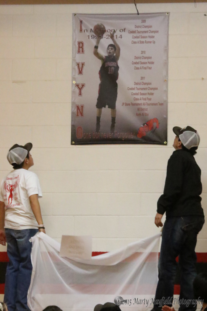 Brothers Jesus and Jose were honored with revealing the banner that now hangs in Sim Brown Gym at Springer High School