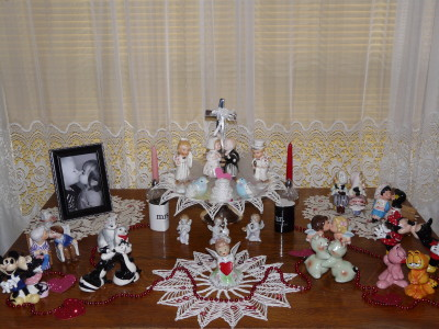 In this Valentine's Day display, examples of the following shaker forms are shown: huggers, kissers, and bench sitters.