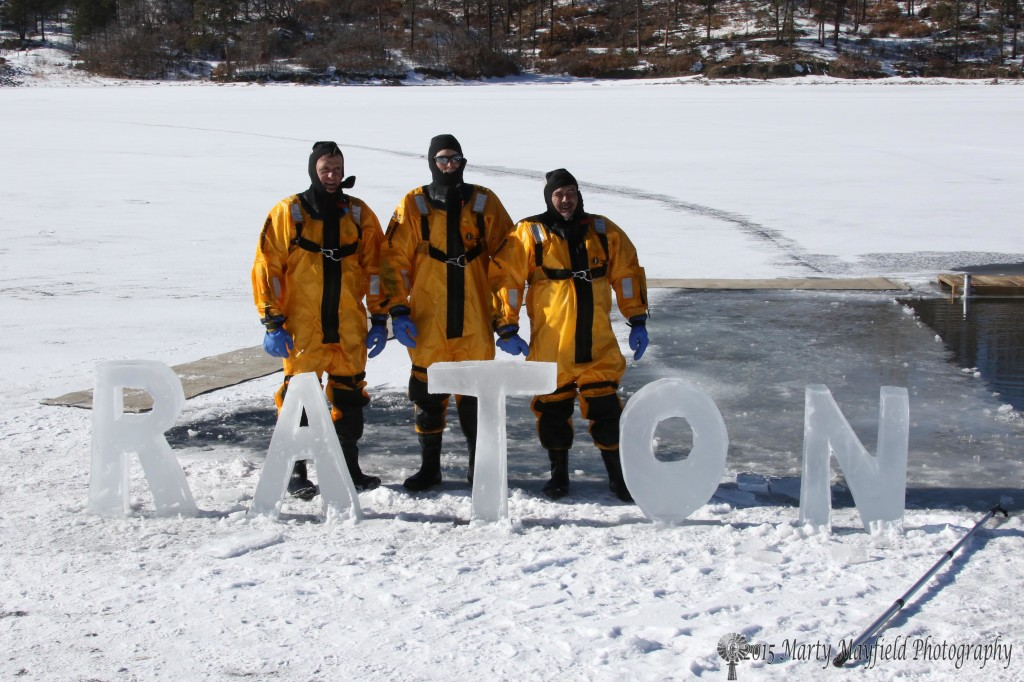 Rick Martin, Bob McIvor and David Gurule behind the ice sculpture that Bob carved out of the ice for the 2015 Polar Bear Plunge. they suited up to help the jumpers brave the fridge waters.