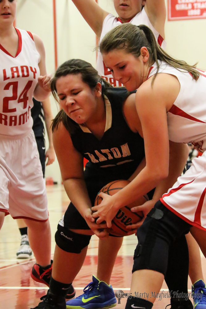 Sydni Silva and Gentry Haukebo wrestle for the ball late in the game in Cimarron Saturday evening.