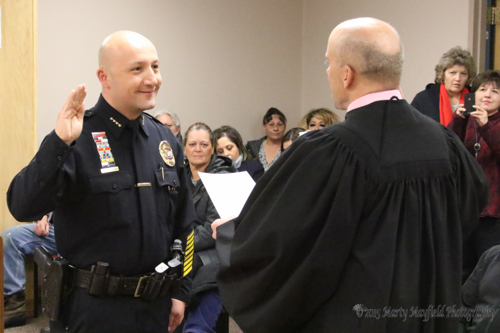 New Raton Police Chief John Valdez was sworn in by Magistrate Judge Warren Walton Thursday evening during the Raton City Commission meeting.