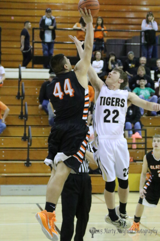 "It was a tough night for the Tigers even from the start as 6' 4"" Mark Craine easily wins the jump ball over Dillon Lemons"