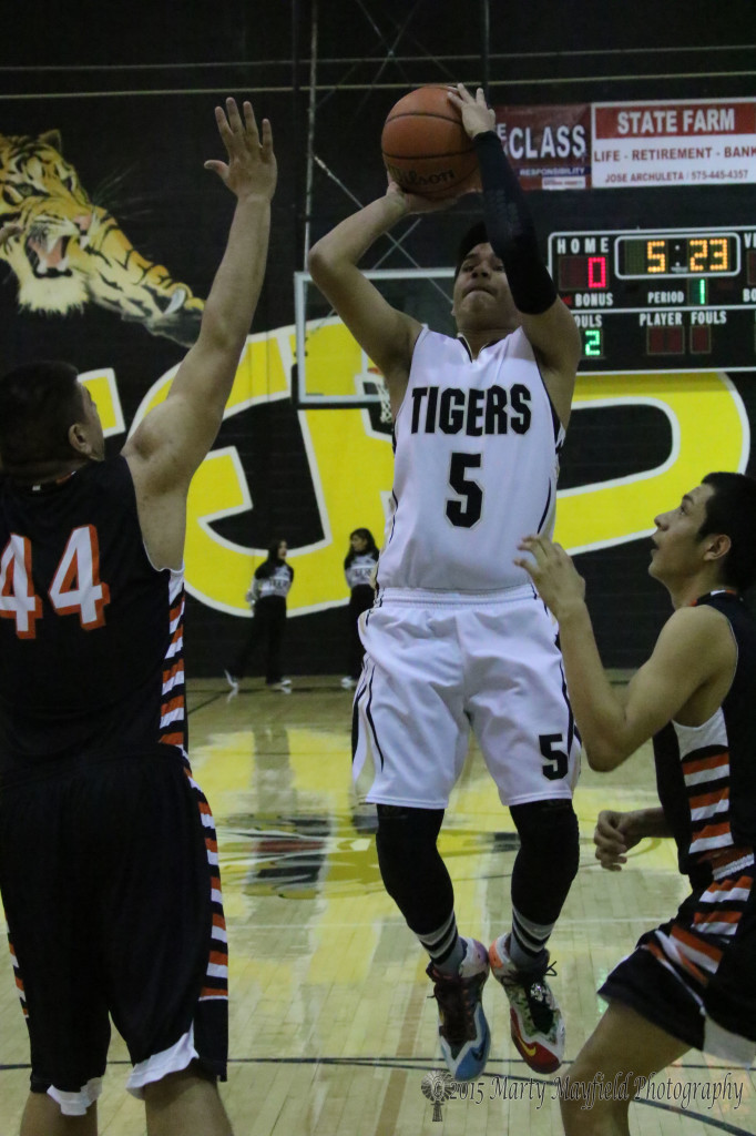 Austin Jones (5) gets inside for the turn around jumper, a play that worked well for the Tigers but one they didn't use much until the fourth quarter.