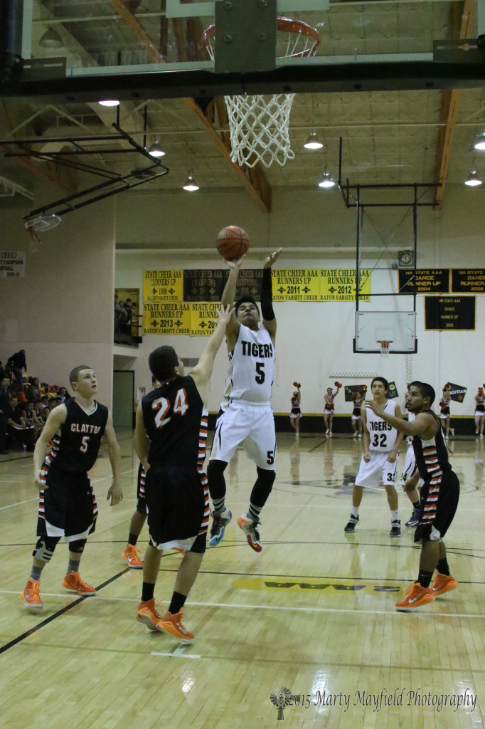 Austin Jones puts up one of his six points on the night late in the game with the Yellowjackets