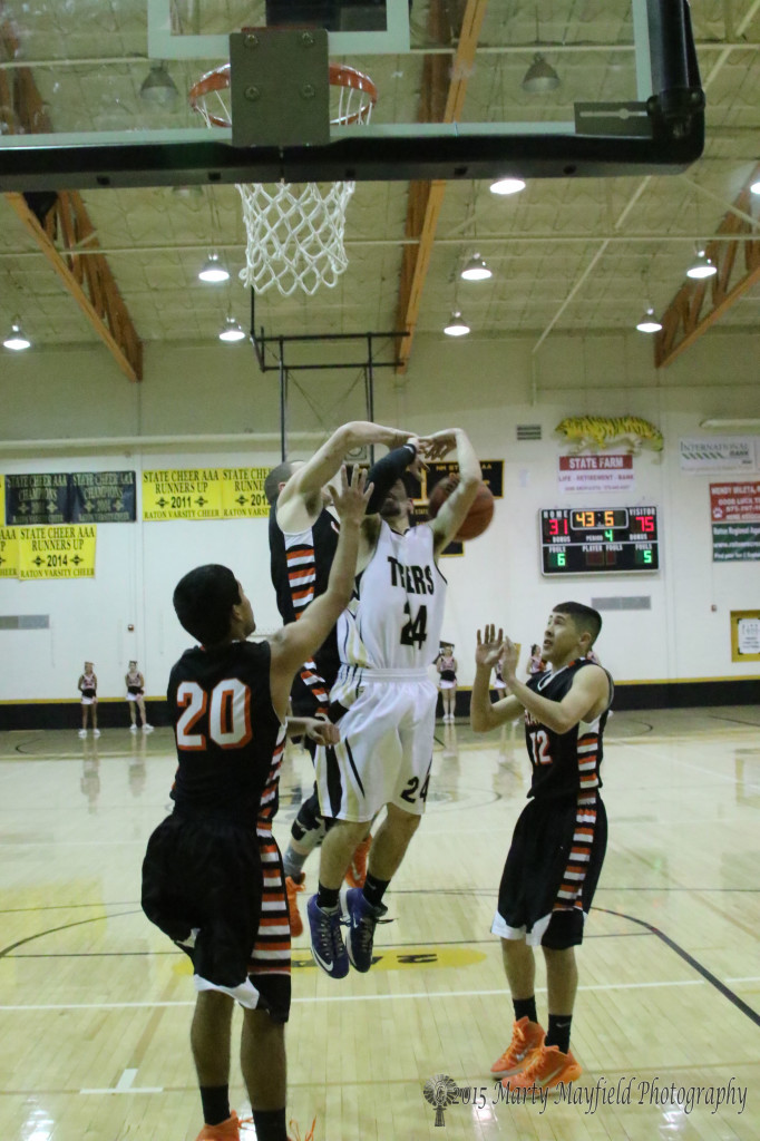 Justin Taylor slams Connel Ware as he takes the jumper late in the game with Clayton Friday night