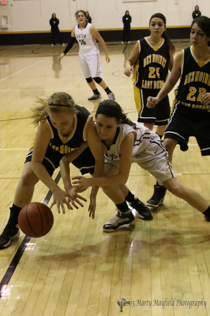 Camryn Mileta and Annalisa Miller go for the loose ball near the end of the game Tuesday evening in Tiger Gym.