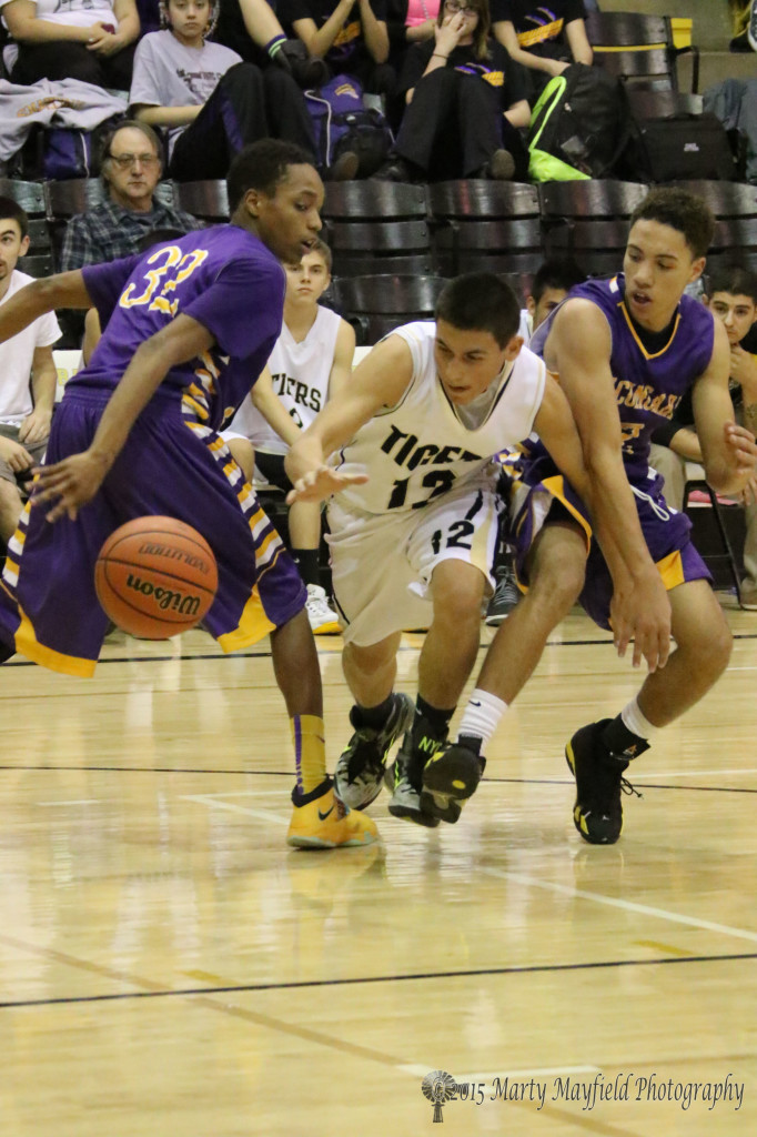 Jodus Gonzales looses the ball as he squeezes through the double team that the Tigers so often found themselves battling Saturday night in Tiger Gym against the Rattlers